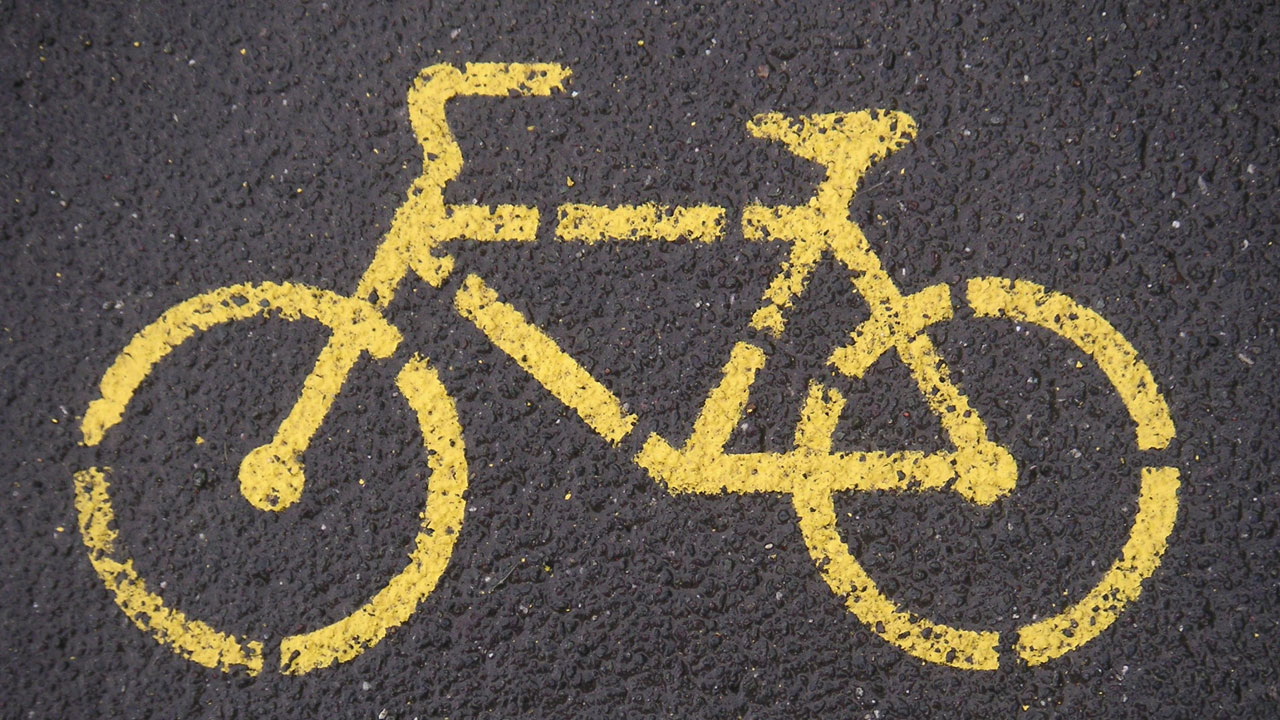 yellow bicycle painted on road, bike path39702780-159532