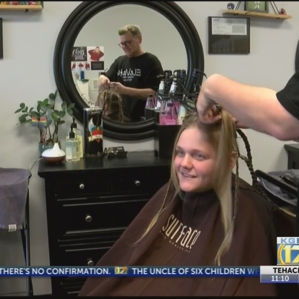 Local boy donates hair after own battle with illness