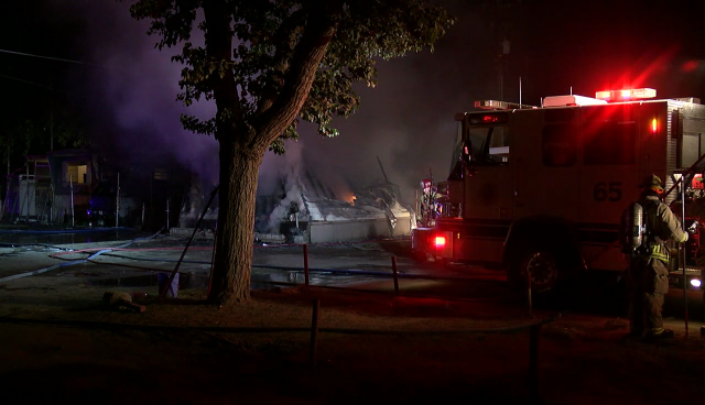 Firefighters on scene of a mobile home fire