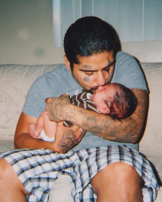 Osuna kissing baby